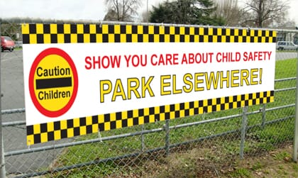 Parking-Safety-Banner-on-a-Fence2