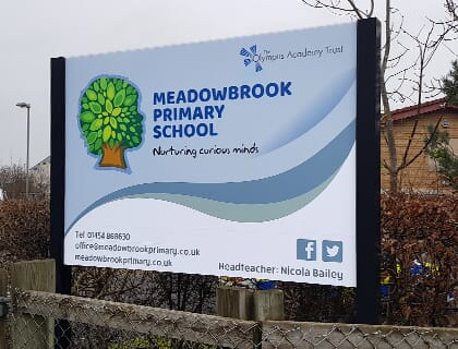 Main School Sign on posts outside of Meadowbrook Primary School