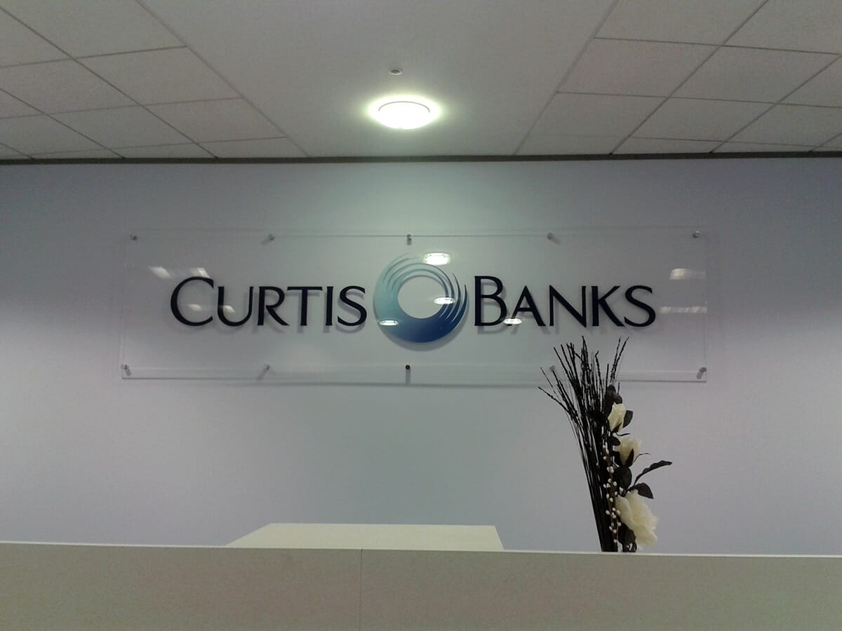 Acrylic Sign by Office Front Desk