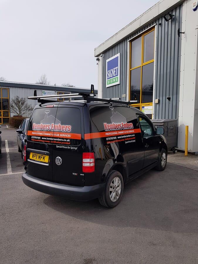 Van Graphics on a Black Mini Van